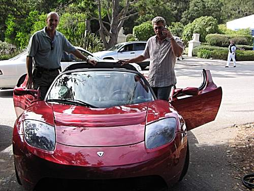 Don Ruggiero and Barry Skolnick with a 2007 Tesla Roadster