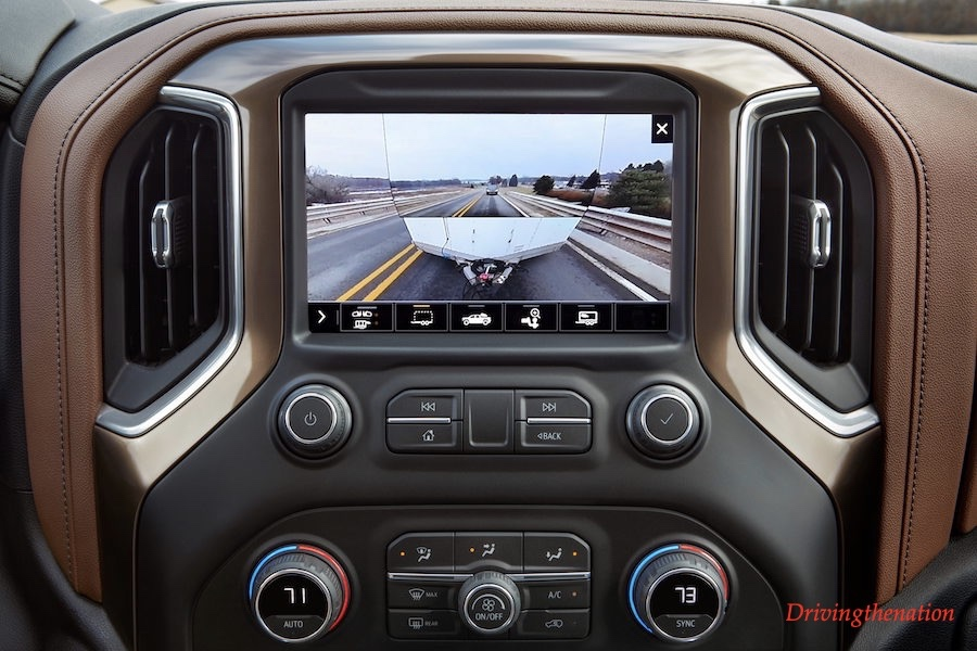 Transparent trailer view, one of 15 camera views part of the 2020 Silverado HD Advanced Trailering System, optimizes the driver's view around the truck and compatible trailers to provide added confidence when towing. The revolutionary transparent trailer feature uses the tailgated-mounted camera and an available accessory camera mounted on the rear of the trailer. The resultant display allows the driver to virtually see through the trailer, a benefit when navigating parking lots, merging into traffic or when making a tight turn.