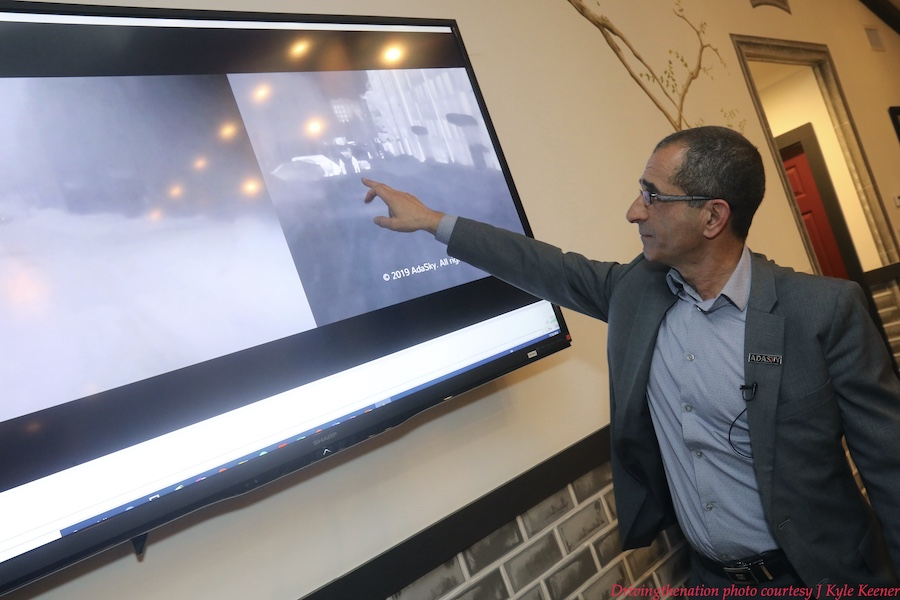 Adasky CEO Yakov Shaharabani shows a comparison of their thermal imaging technology, right, during a foggy event, compared to high definition camera, on left, at a press event at CES 2020. Photo by J. Kyle Keener