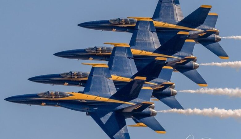 The US Navy Blue Angels diamond in a tight, close-formation pass. The Blue Angels Demonstration Team will headline the 2017 Wings Over North Georgia Air Show.