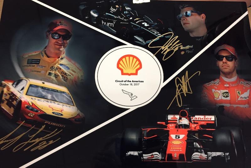 autographed picture of Joey Logano, Josef Newgarden, and Sebastian Vettel