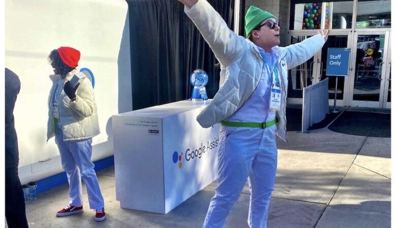 A Google employee jumps for joy when a visitor to CES won a prize at a giant sized slot machine that was part of their display at the Las Vegas Convention Center, home of CES 2020. Photo by J. Kyle Keener