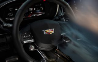 The 2022 Cadillac CT5-V Blackwing and CT4-V Blackwing will feature a performance steering wheel meticulously crafted with leather and cut-and-sewn stitching, a 12 o'clock red racing stripe, carbon fiber trim and a V-Series emblem. Pre-production steering wheel shown. Actual production steering wheel may vary.